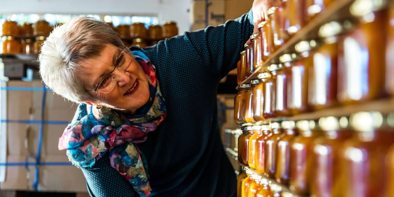Business woman Ina Lessing, does the usual things extraordinarily well and is seen inspecting rows of freshly made jam packed on shelves.
