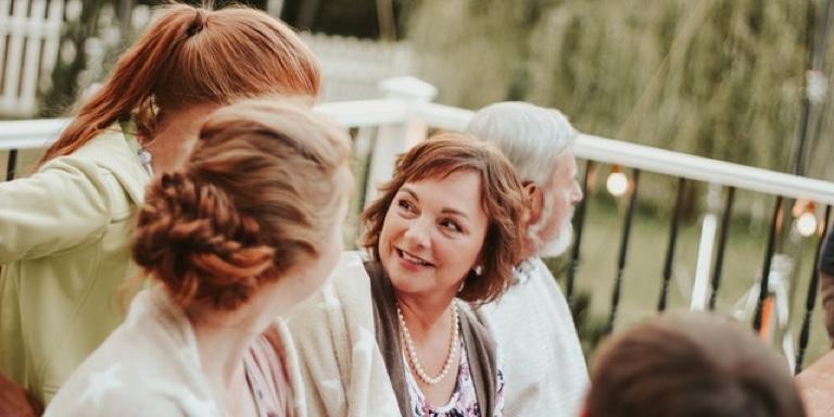 momentum wellness ewp women with pearls chatting