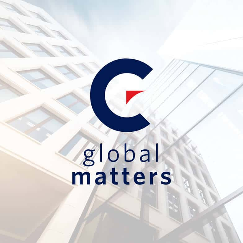 The Momentum Global Matters logo against a faded multistory office building backdrop and a light blue sky.