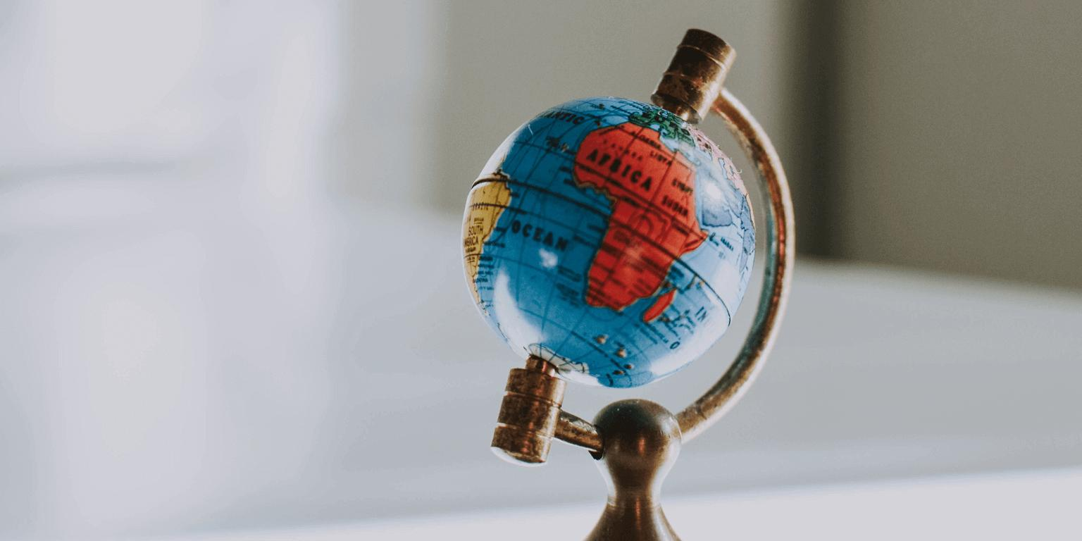 An ornamental globe placed on a desk with the main focus on the continent Africa.